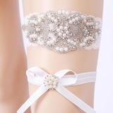 2-Piece/Elegant Lace With Rhinestone/Pearl Wedding Garters (104209494)